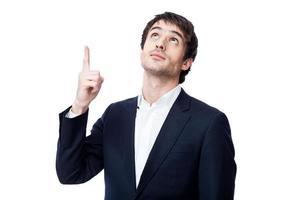 affärsman som pekar på kopieringsutrymme foto