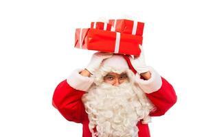 jultomten med gåvor isolerad på vitt, med kopia utrymme foto