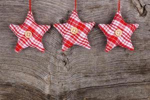 röd tyg stjärna god jul dekoration rustik trä bak foto