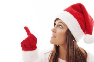 julkvinna som pekar på kopieringsutrymme foto