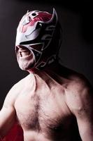 italiensk luchador maler sina tänder foto