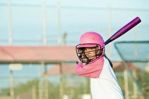 liten flicka baseball smet foto