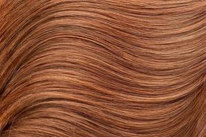 långt rött mänskligt glansigt hår foto