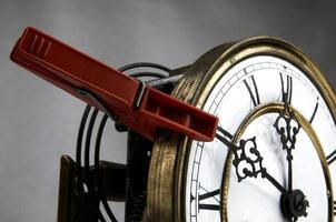 klädnypa stoppa klockan foto