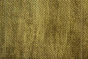 stickad textil på nära håll foto