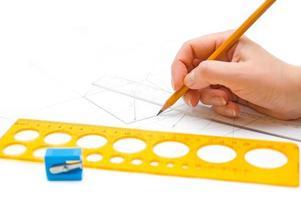 hand, rita en skiss foto