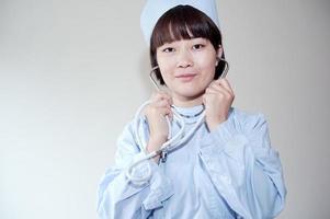 sjuksköterskor i arbetet leende foto