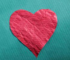hjärta, isolerad på blå bakgrund. foto
