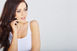 kvinna med en mobiltelefon foto
