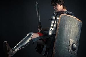 den brutala krigaren av Sparta träffar foten foto