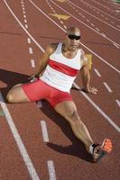 idrottsman som värmer upp foto