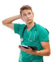 tankeväckande manlig läkare foto