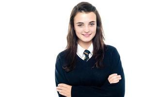 självsäkert ung skolbarn i uniform foto