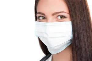 läkare som bär kirurgisk mask foto