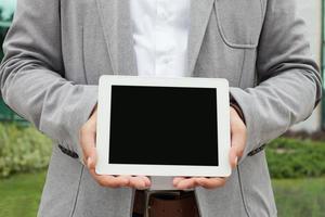 affärsman med digital surfplatta foto