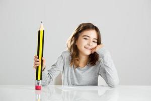 liten flicka i skolan foto