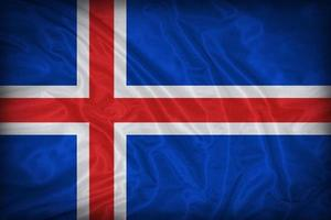 Island flagga mönster på tyg textur, vintage stil foto