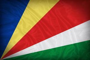 Seychellerna flagga mönster på tyg konsistens, vintage stil foto
