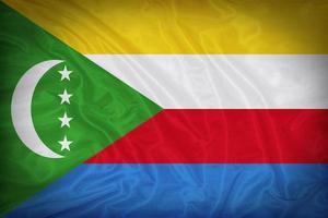 Komorerna flagga mönster på tyg konsistens, vintage stil foto