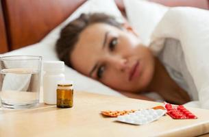mediciner för sjuk kvinna foto