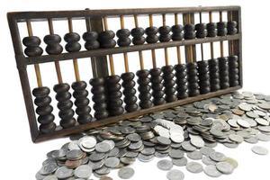 abacus och mynt foto