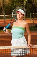 porträtt av tennisspelare för ung kvinna foto