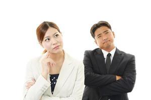 missnöjd affärsman och affärskvinna foto