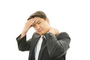 affärsman som har huvudvärk foto