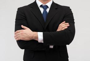 närbild av buisnessman i kostym och slips foto