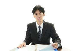 porträtt av en asiatisk affärsman foto