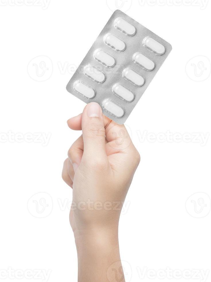 hand houden van medicijnen foto