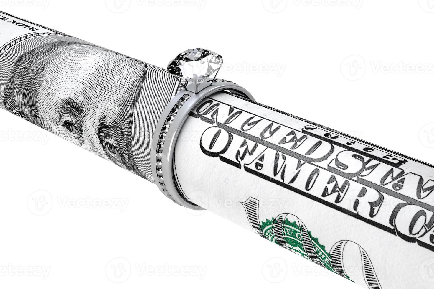 honderd dollarbiljet in een diamanten trouwring foto