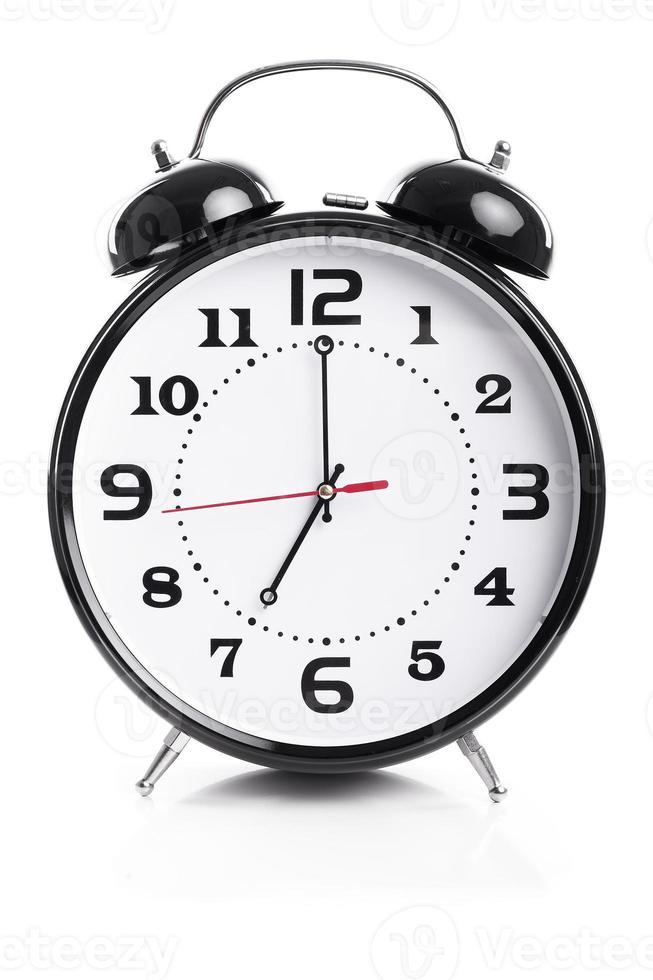 tijd voor werk - wekker toont zeven uur foto