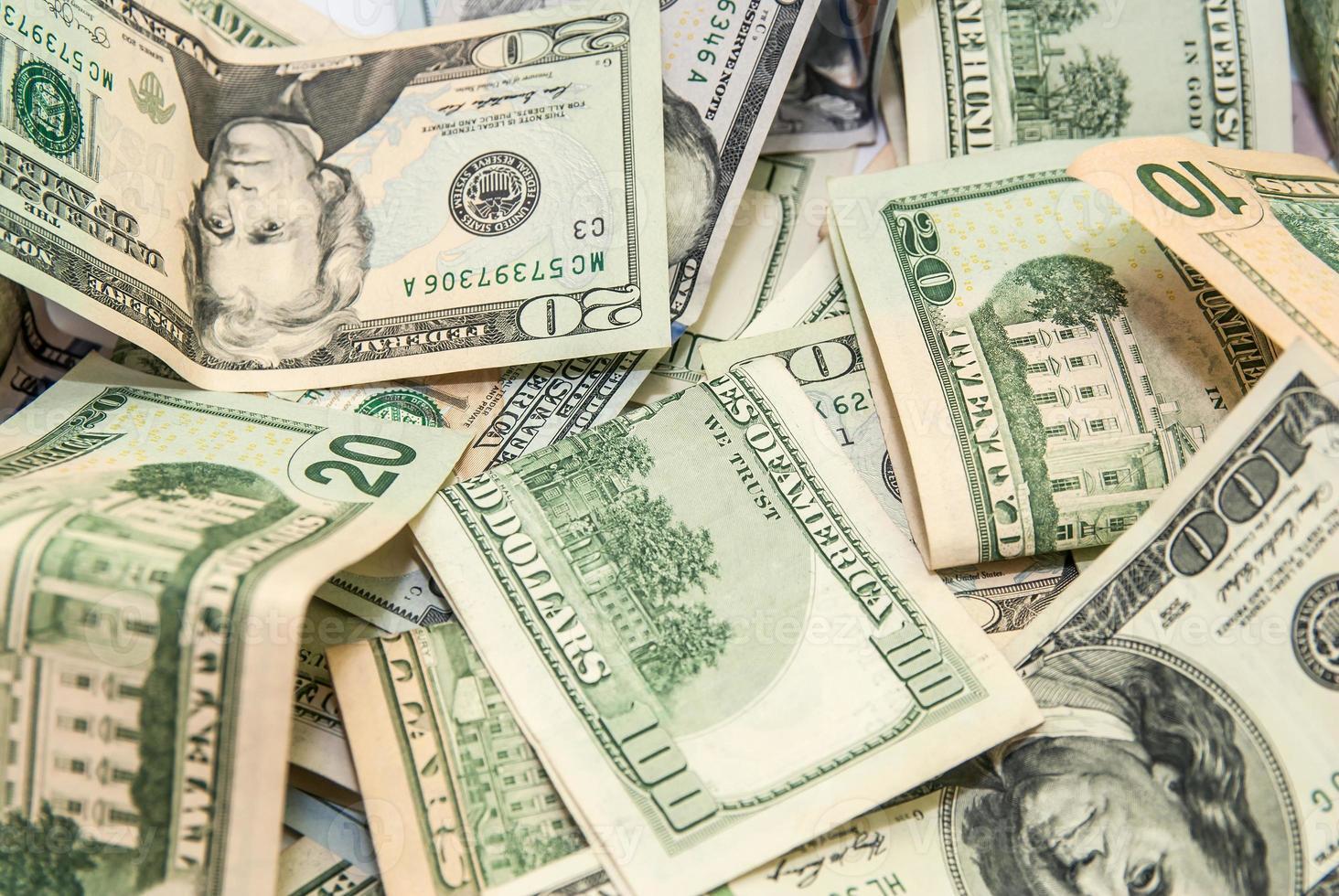 de achtergrond van dollarbankbiljetten foto