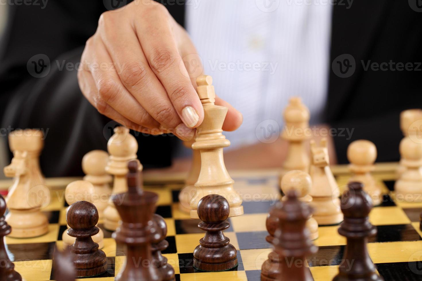 zakenvrouw schaken foto