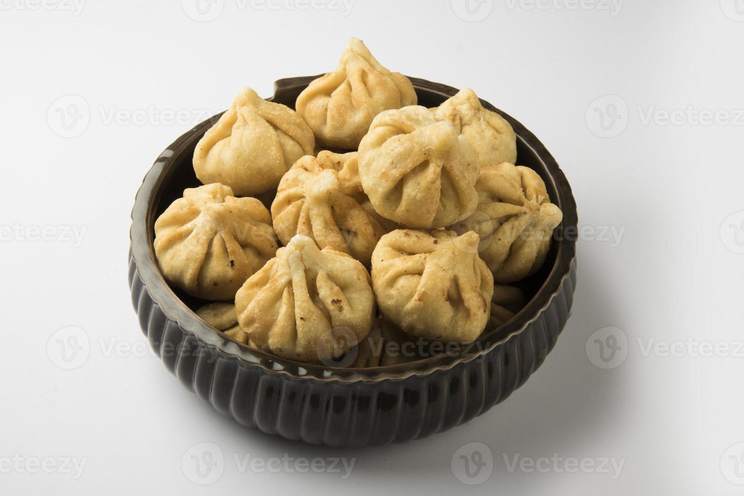 geserveerd plaat van heilige Indiase zoete recept modak foto