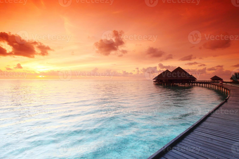 Maldivische huizen op zonsopgang foto