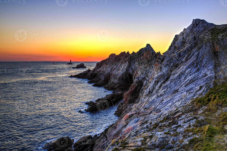 zonsondergang aan het einde van de wereld foto