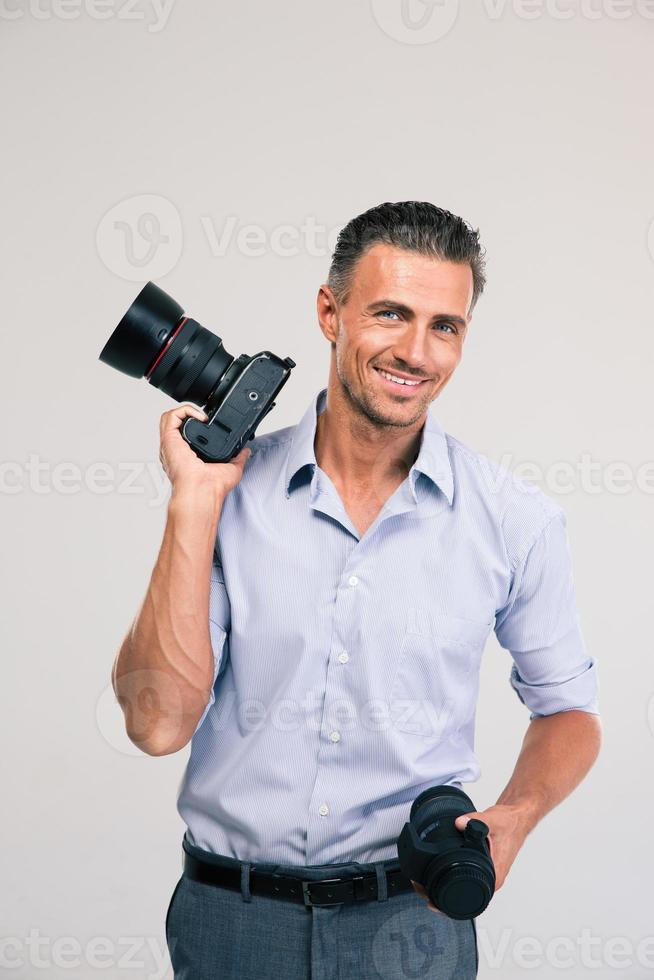 knappe fotograaf bedrijf camera foto