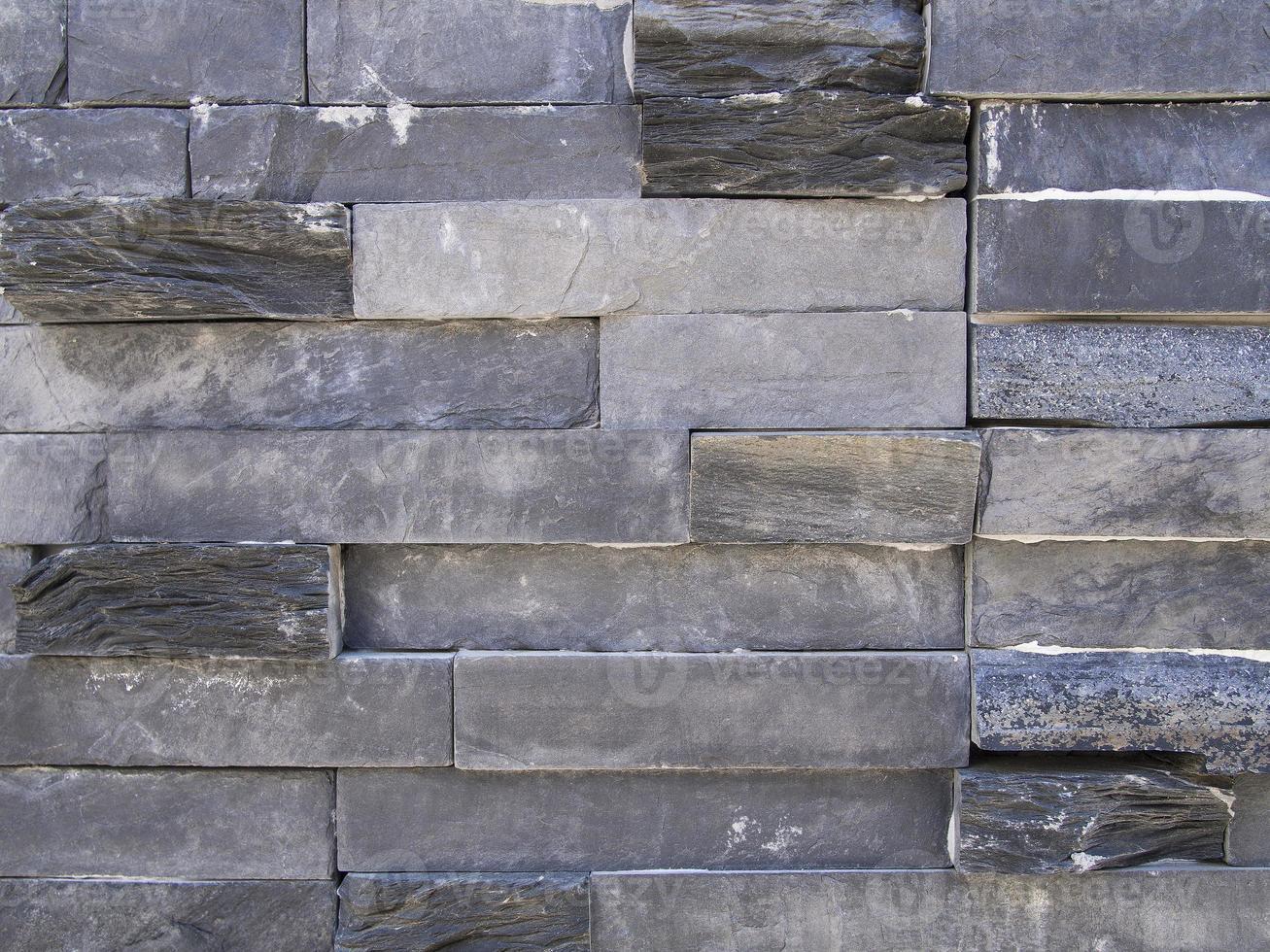 muur van grijze steen foto