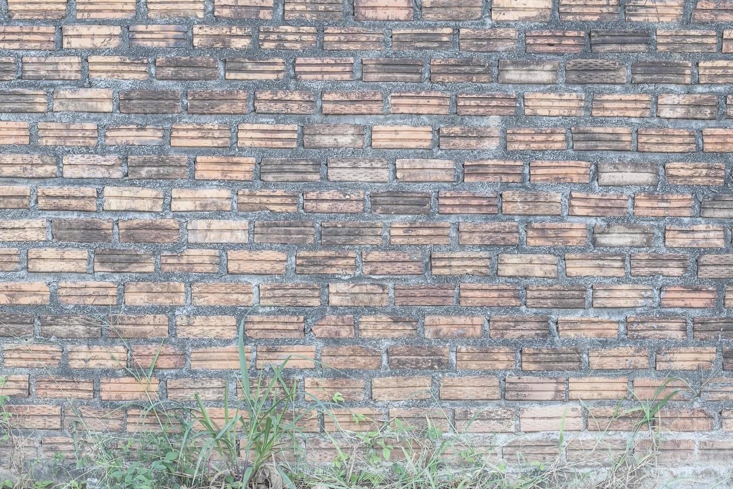 oude bakstenen muur voor achtergrond of textuur foto
