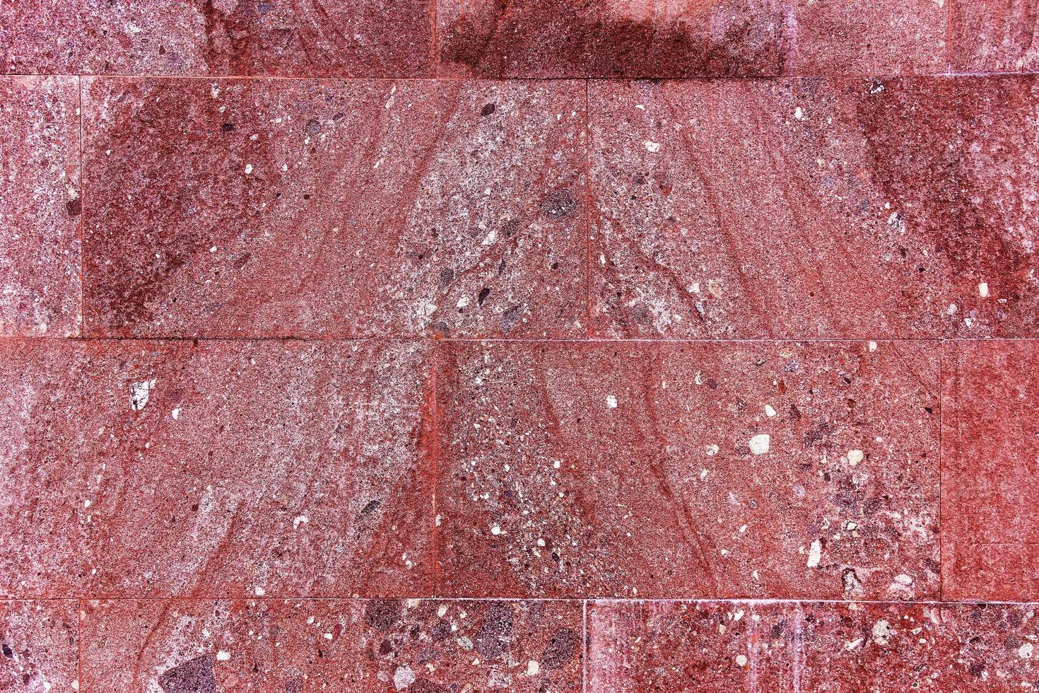 rode gestructureerde marmeren achtergrond, decoratieve wandtegels foto
