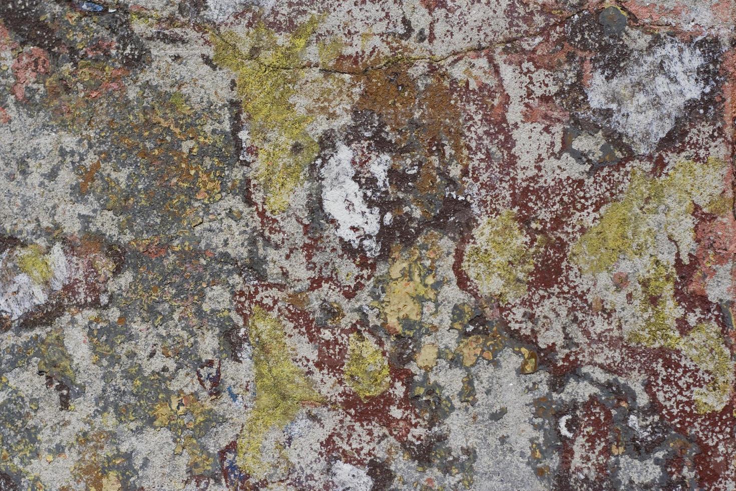 kleurrijke noodlijdende cementmuur foto