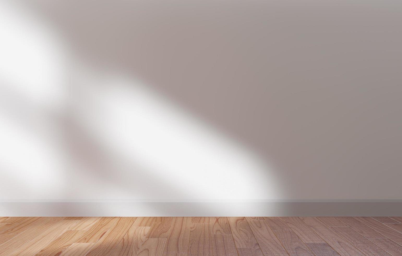 neutrale muur en zonlicht met schaduwen foto