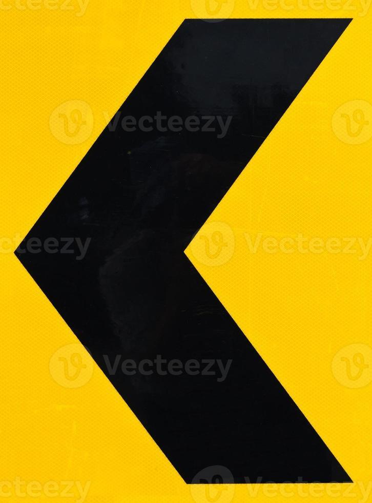 zwarte en gele pijl waarschuwingsteken foto