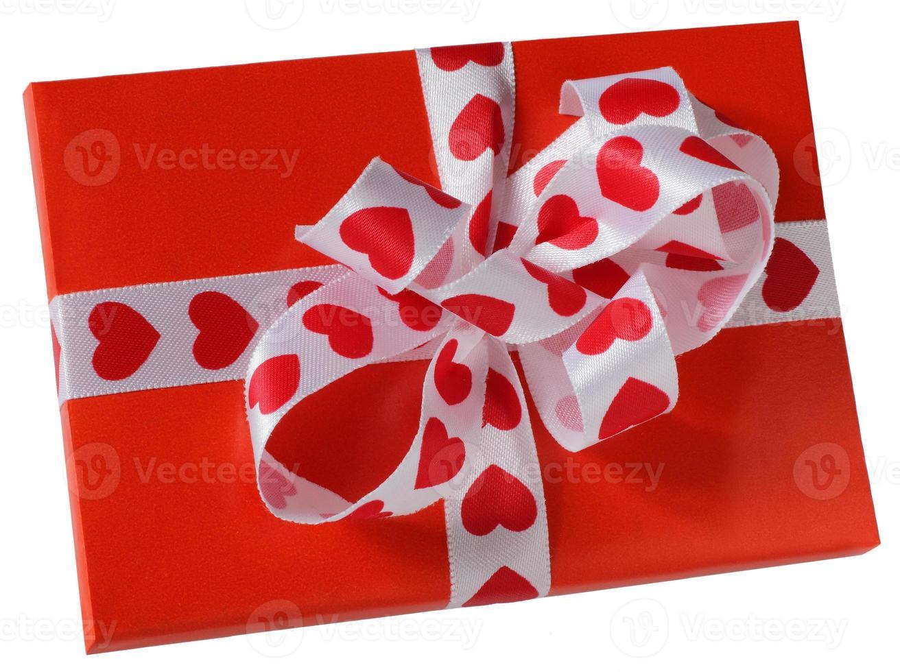 rood pakket met een wit lint foto