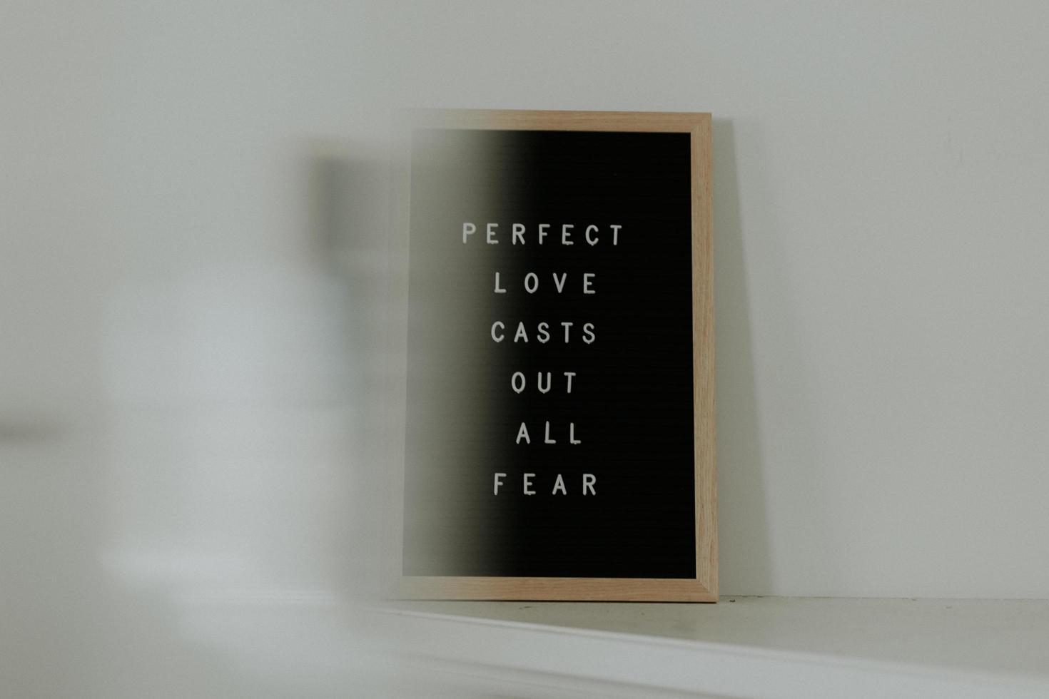 bruin houten frame met quote foto