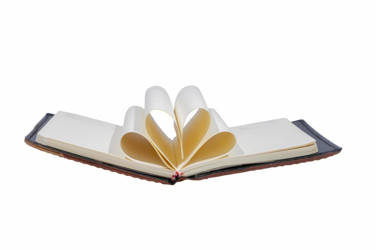 open boek op witte achtergrond foto