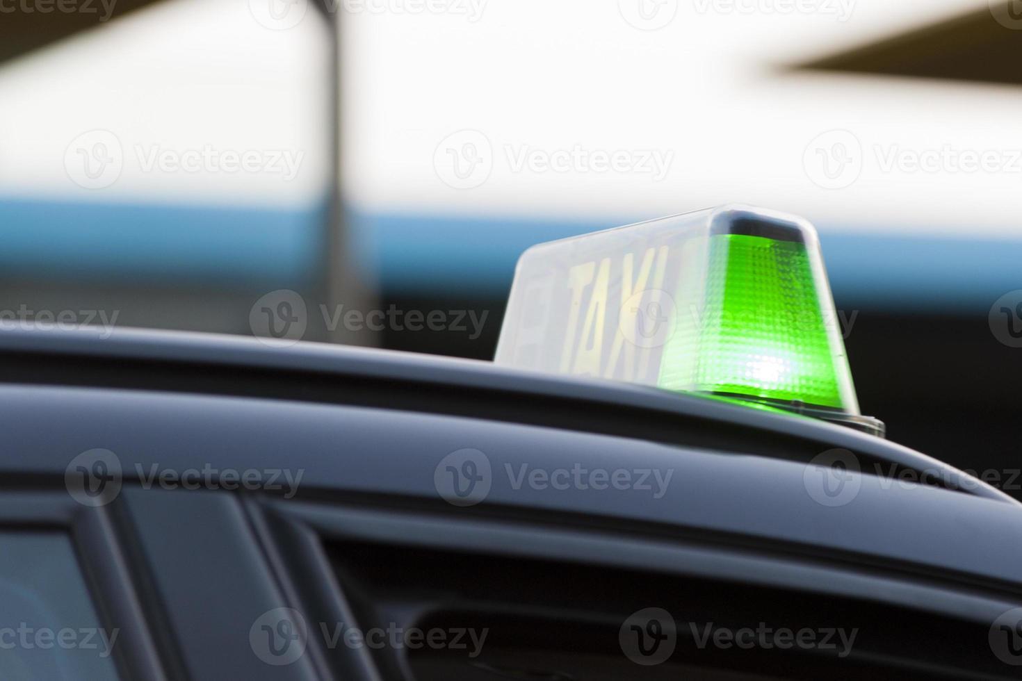 groen licht op een taxi foto