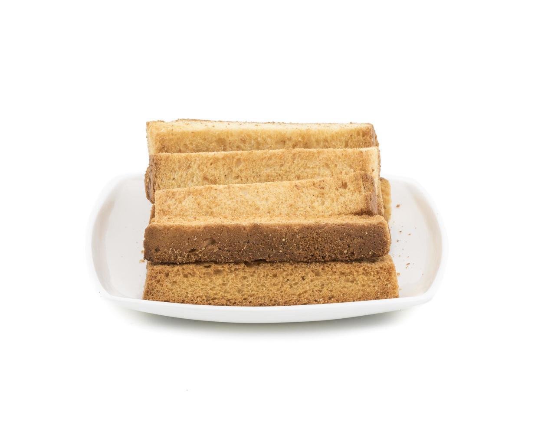 toast stokken en plaat op een witte achtergrond foto